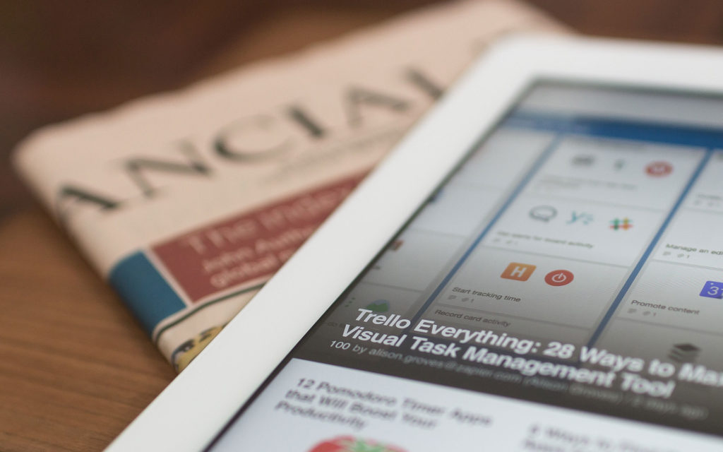 close up of news story of tablet